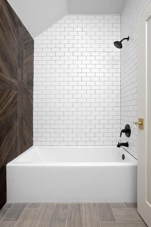 A Drop In Bathtub Is Accented With White Subway Tiles