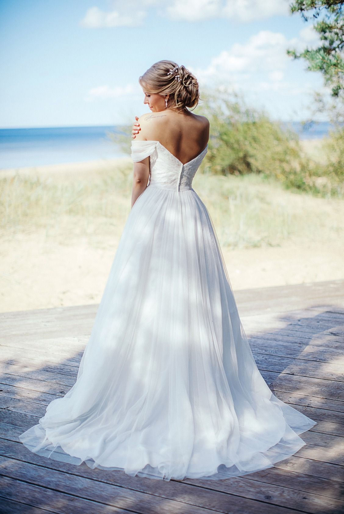 A ball gown is an unexpected choice for a beach wedding