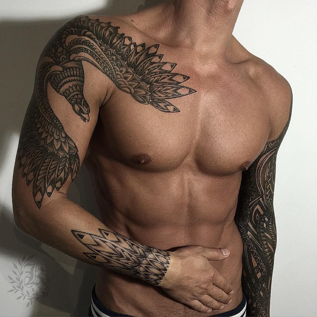 Good looking mens tribal tattoo. Bird tattoo. Tattoo