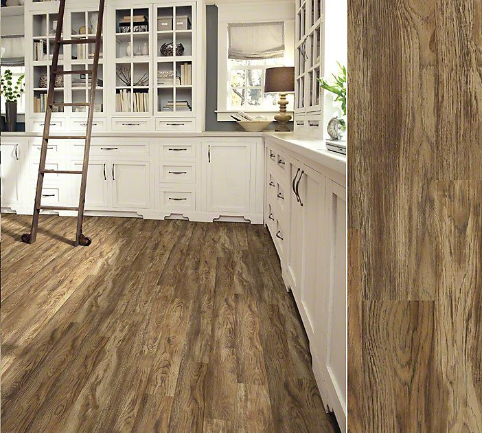 LVT this is vinyl... How cool is that! Shaw Array luxury