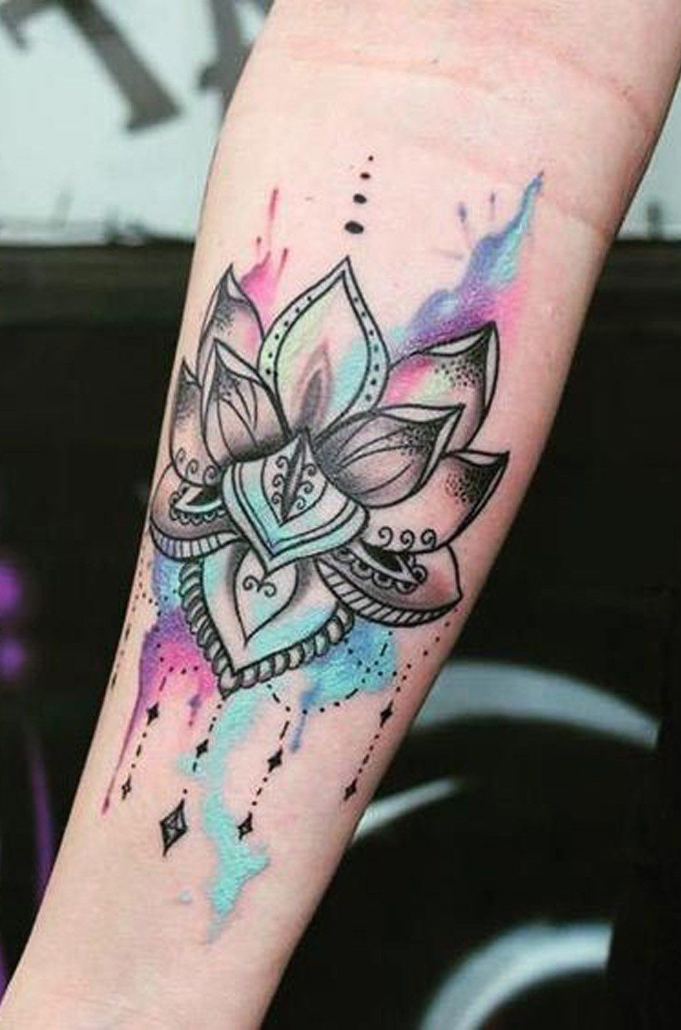 Watercolor Lotus Flower Wrist Tattoo Ideas for Women at