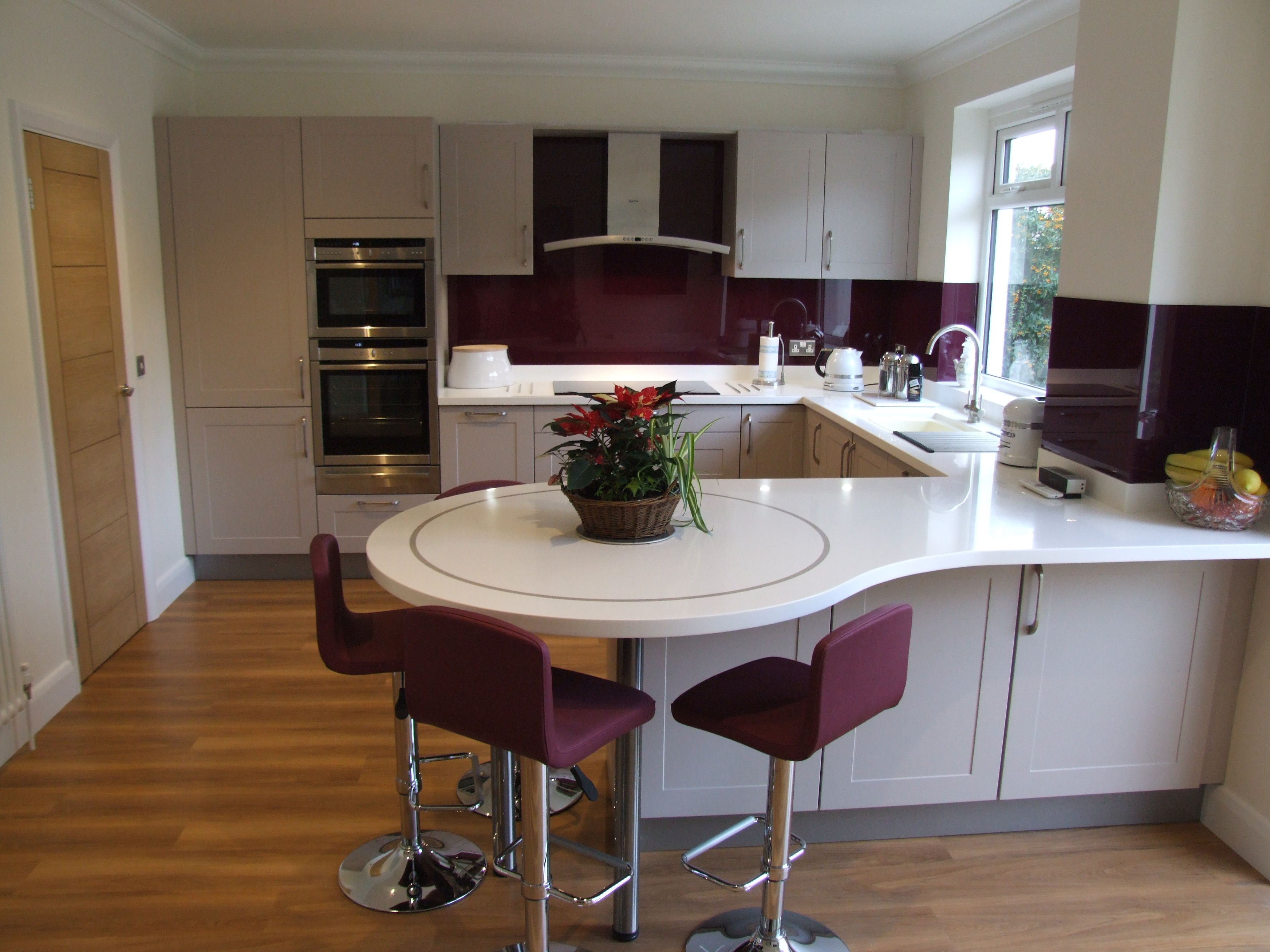 Modern painted kitchen with lovely circular breakfast bar
