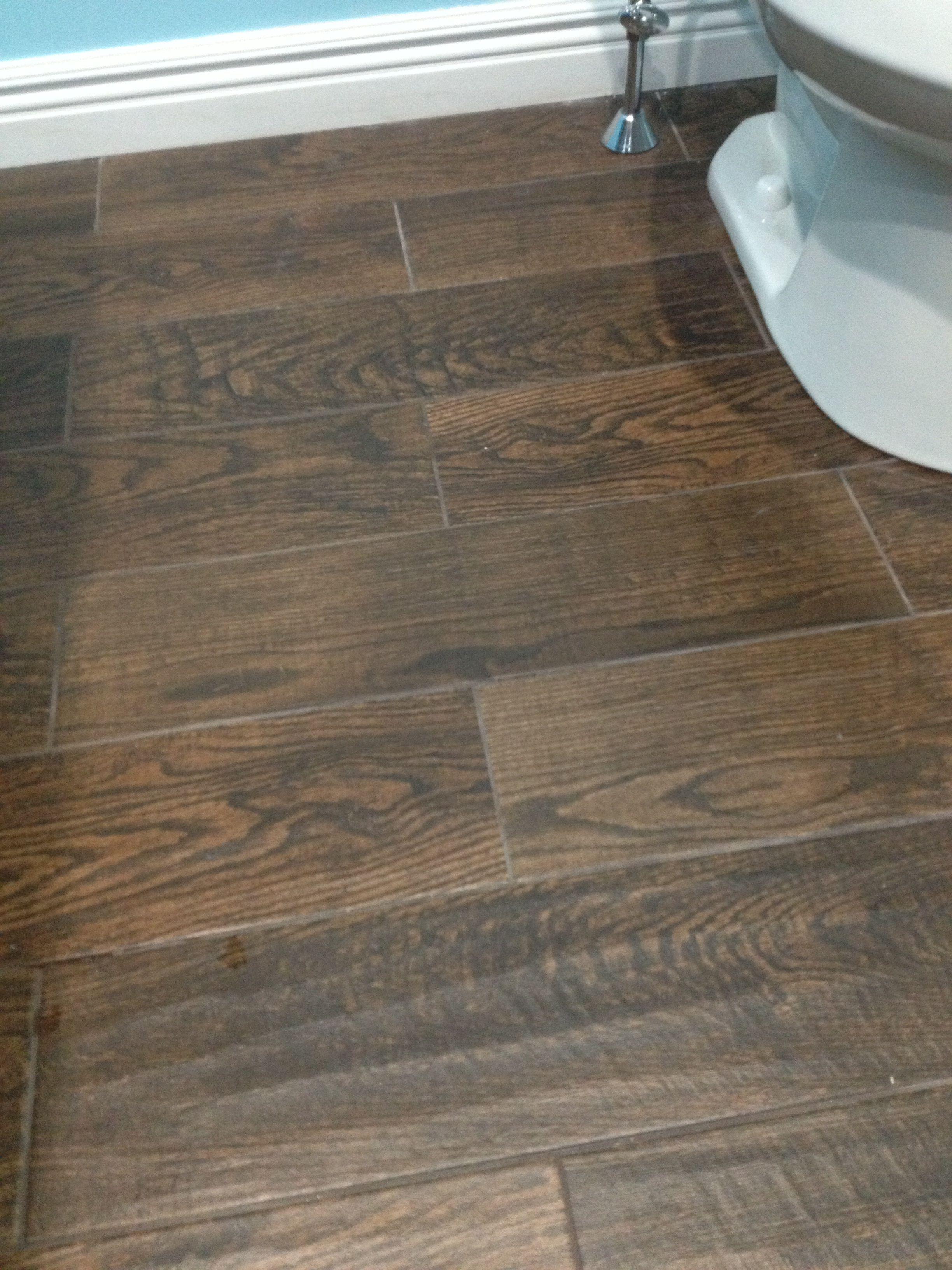 Porcelain wood look tile in upstairs bathroom. Home Depot