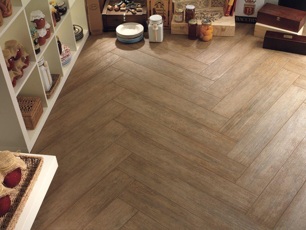 Tile which looks like wood, love the herringbone by
