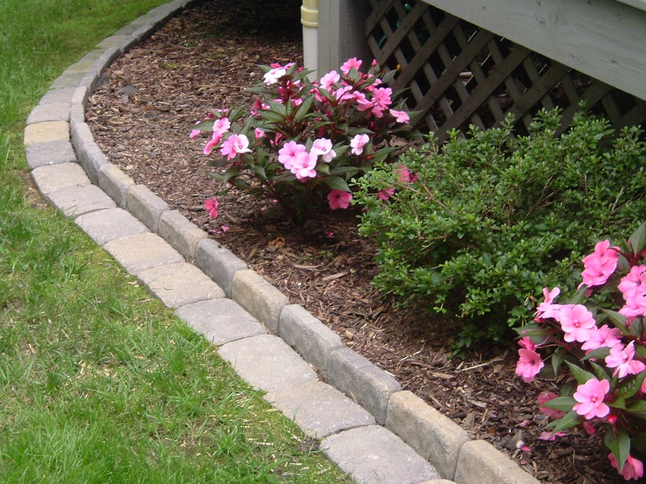 Edging a Flower Bed With Cement Pavers This link gives you