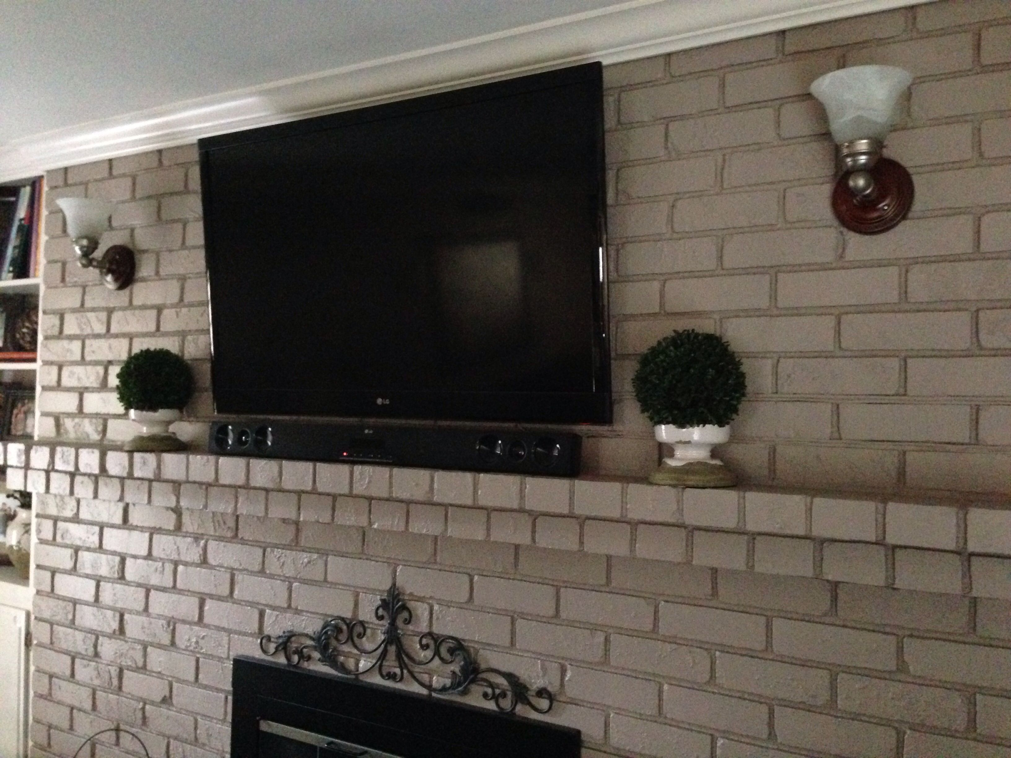 Yes, You Can Mount Your Tv To Your Brick Fireplace Without