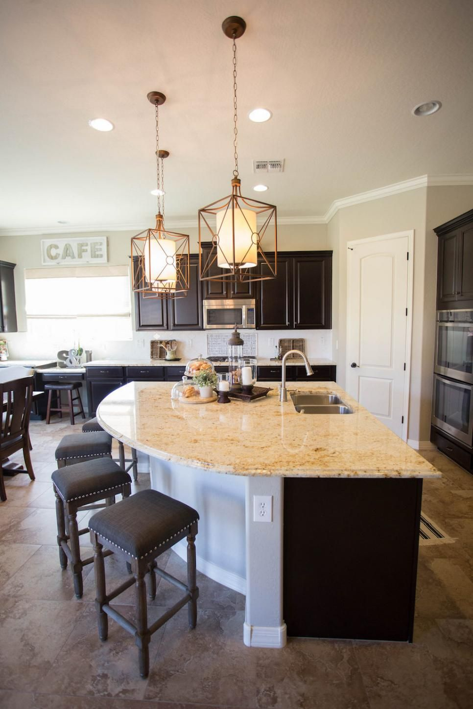 The unique curved kitchen island provides extra casual