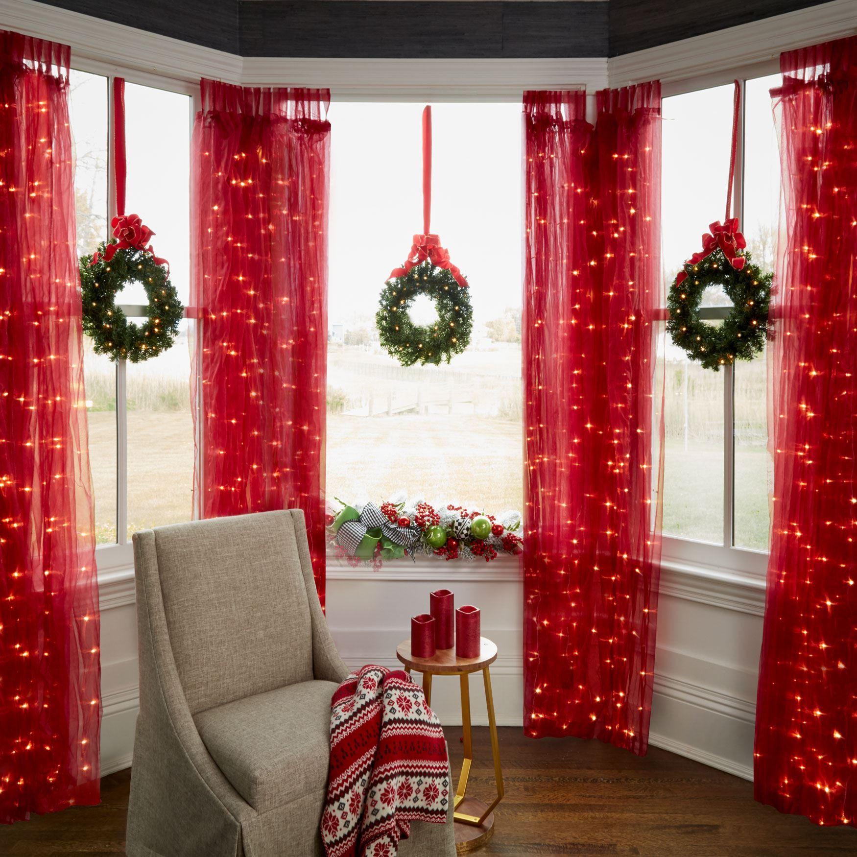 A festive trio of mini Christmas wreaths, each gleaming