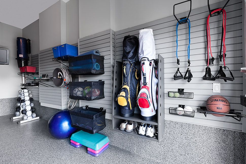 Garage gym Look how yoga mats were rolled & placed into