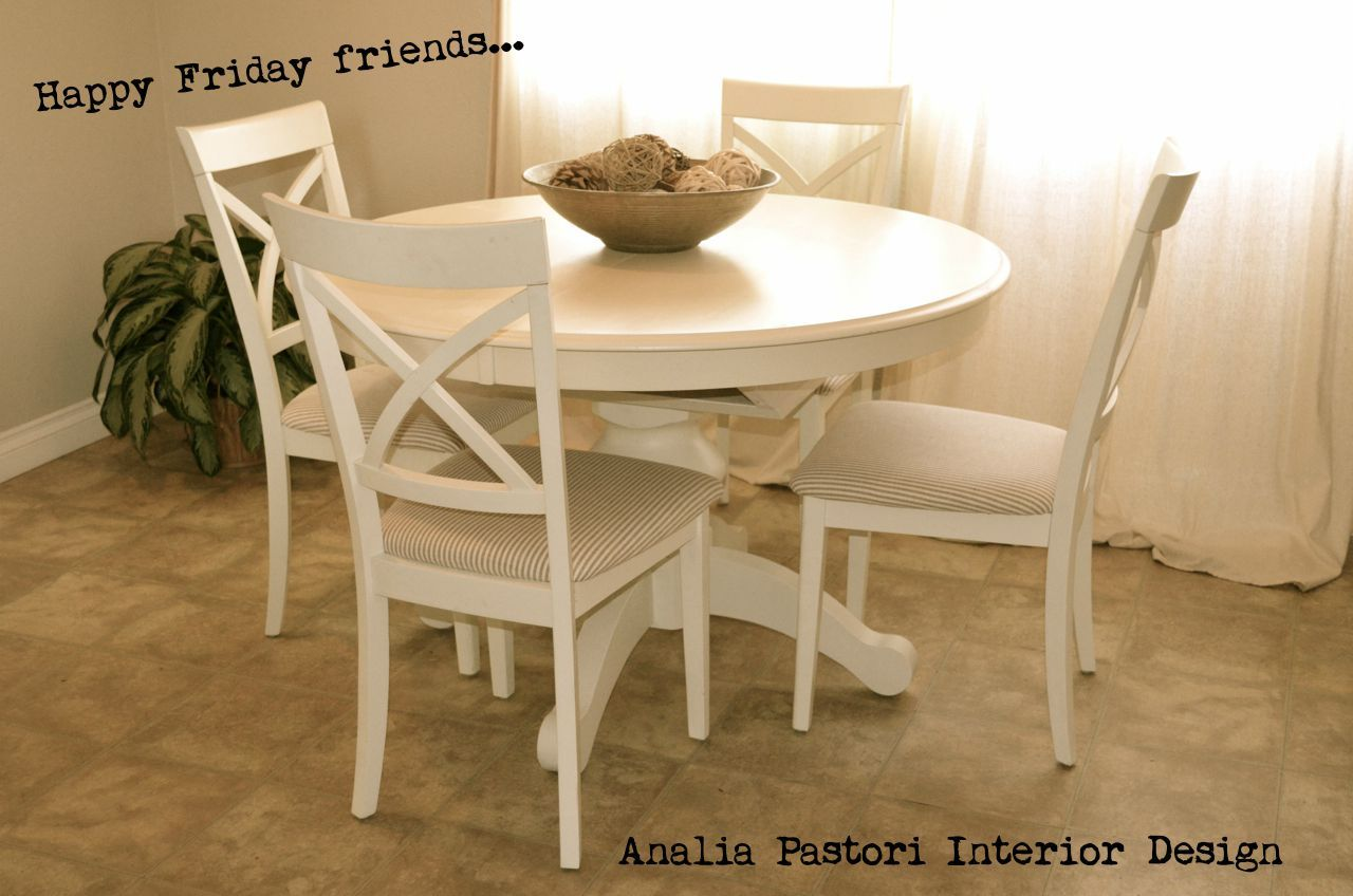 Farmhouse style distressed antique white round table and