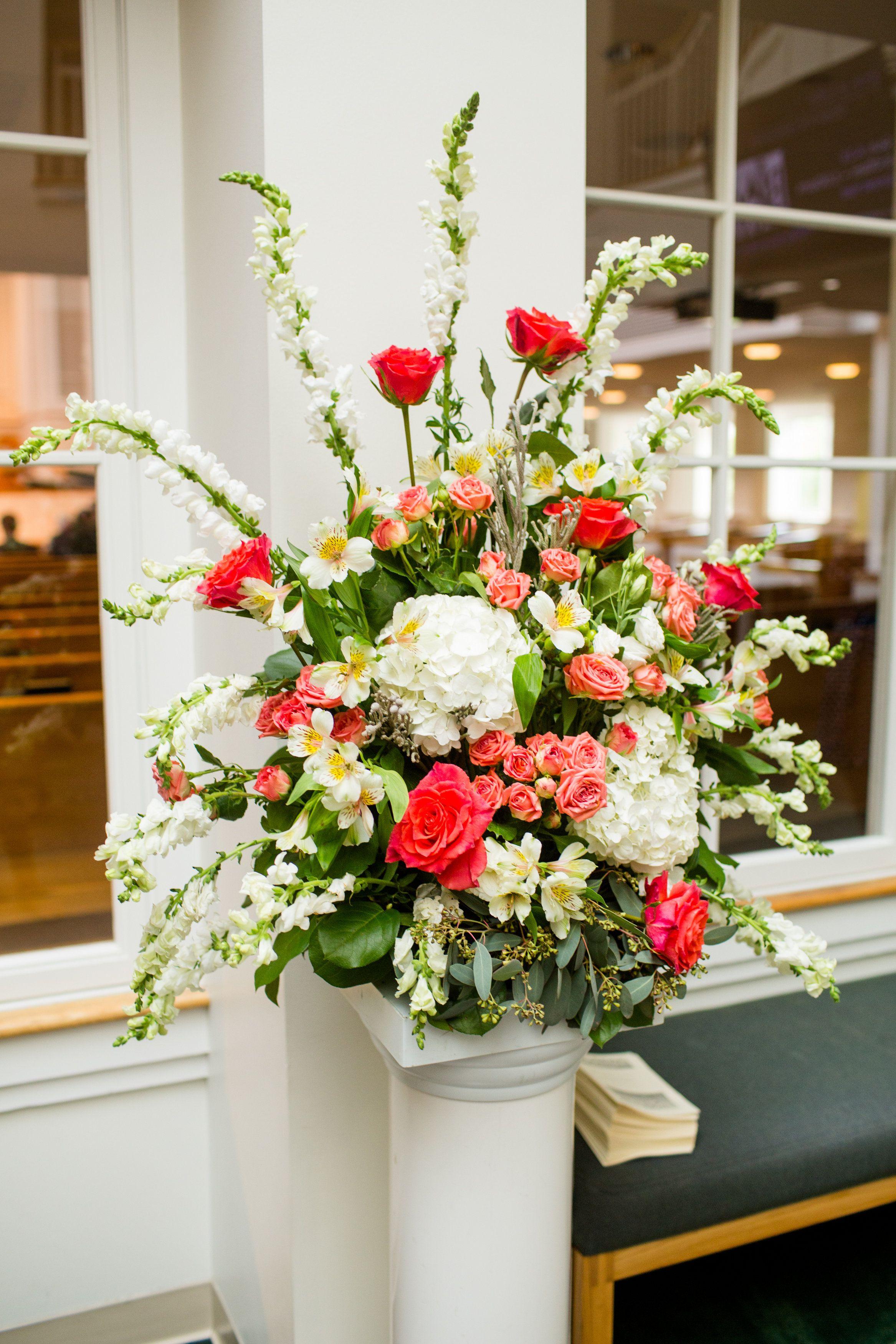 Church Alter arrangement of coral roses, white hydrangeas