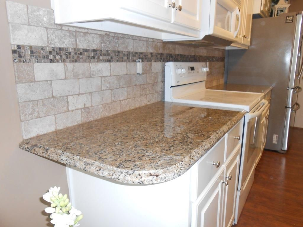 - Granite Countertop With Travertine Tile Backsplash. Travertine