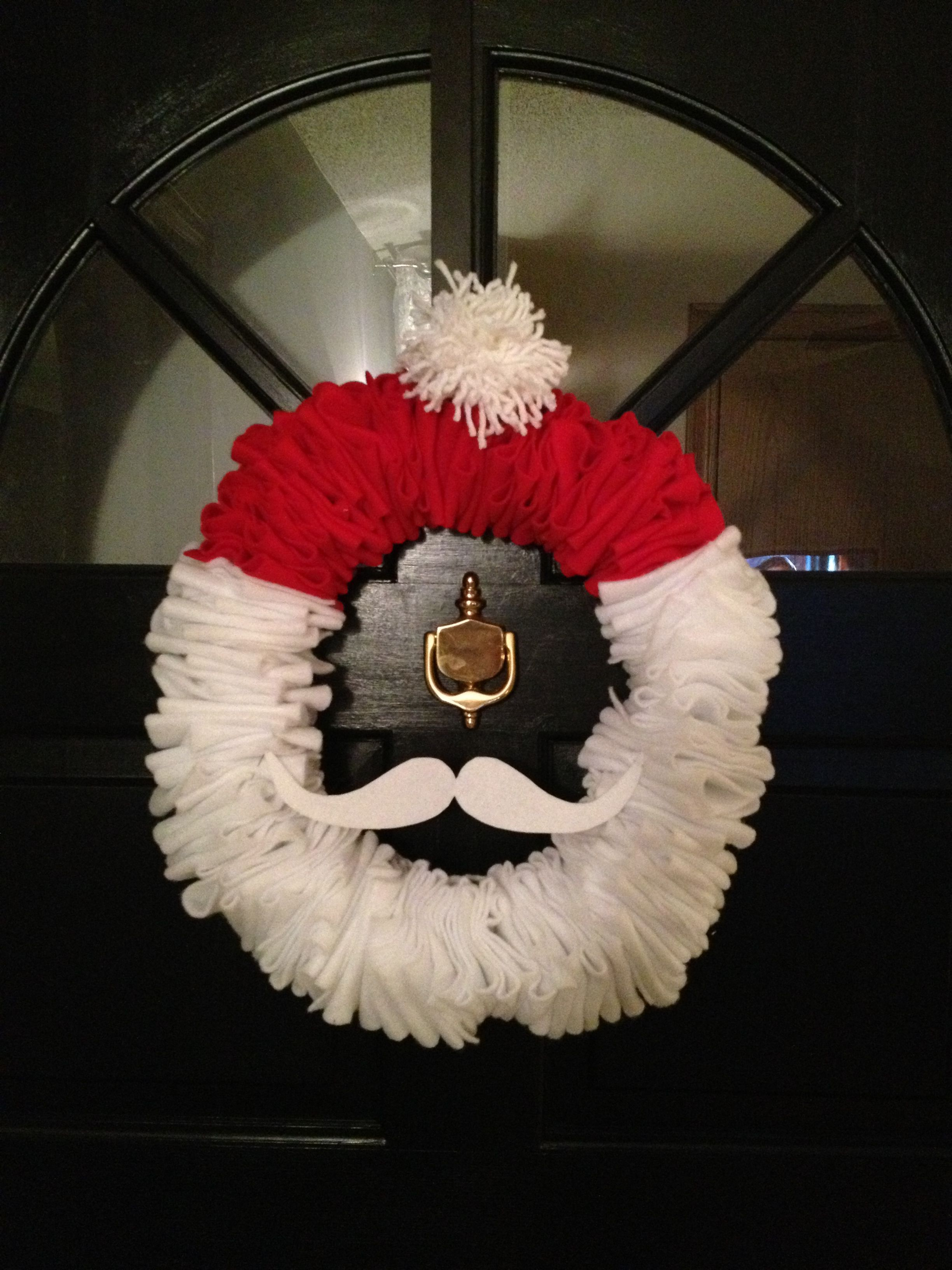 Christmas Santa wreath made from a wire hanger, felt and
