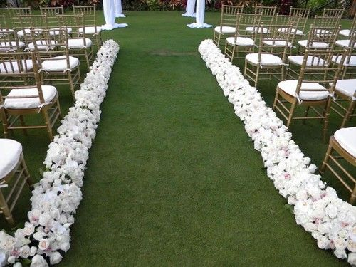 Just Flowers To Define The Lawn For The Wedding Aisle