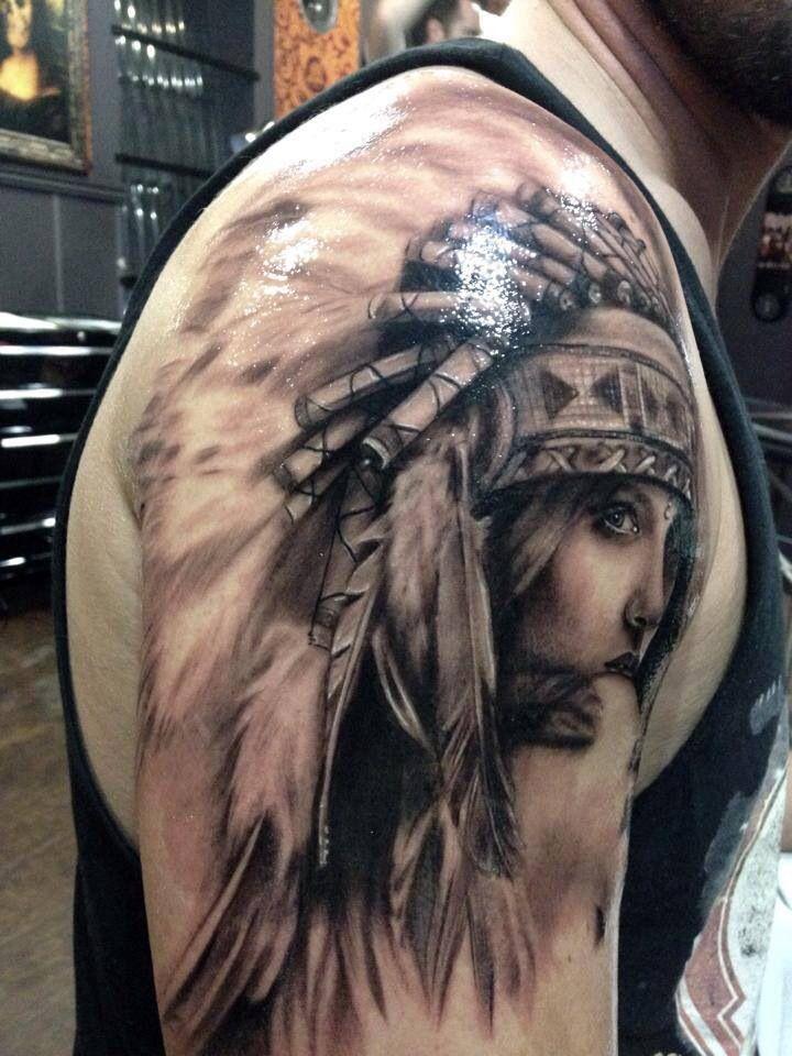 Girl in a feather headdress tattoo. I