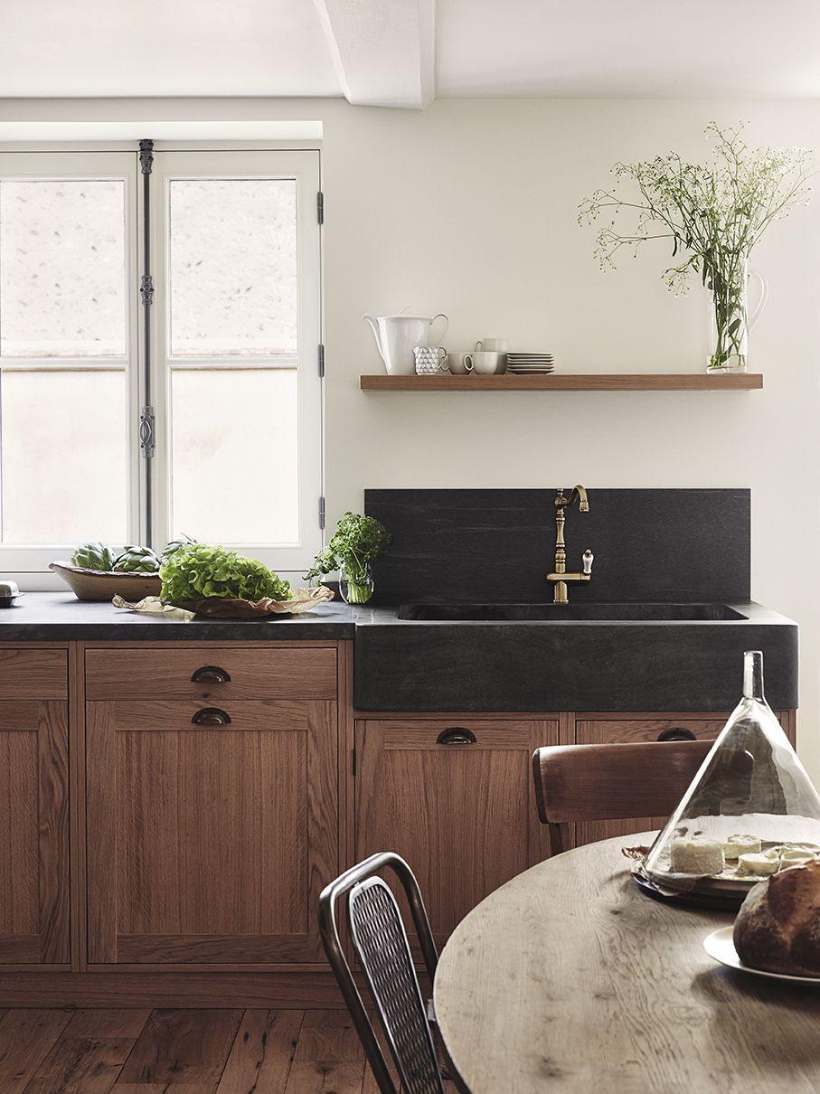 stunning black concrete farmhouse sink with walnut