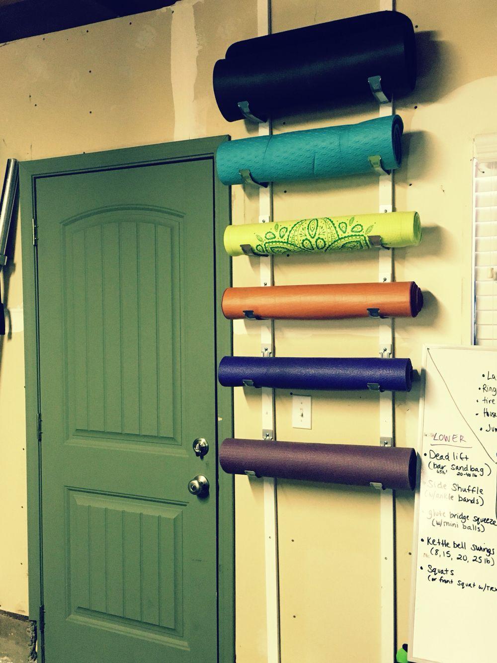 DIY yoga mat and foam roller holder for home gym. Each set