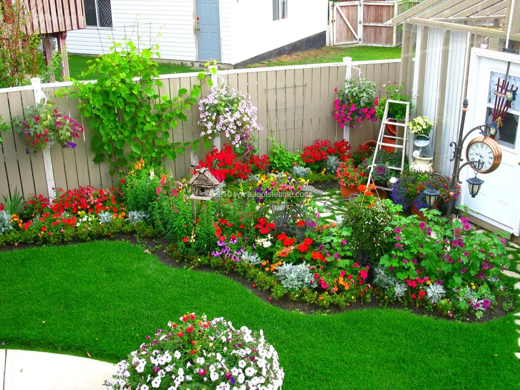 From Tootsie Time. I love the backyard flower garden Red