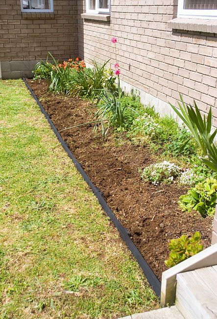 finished flower bed border made from pallets For the