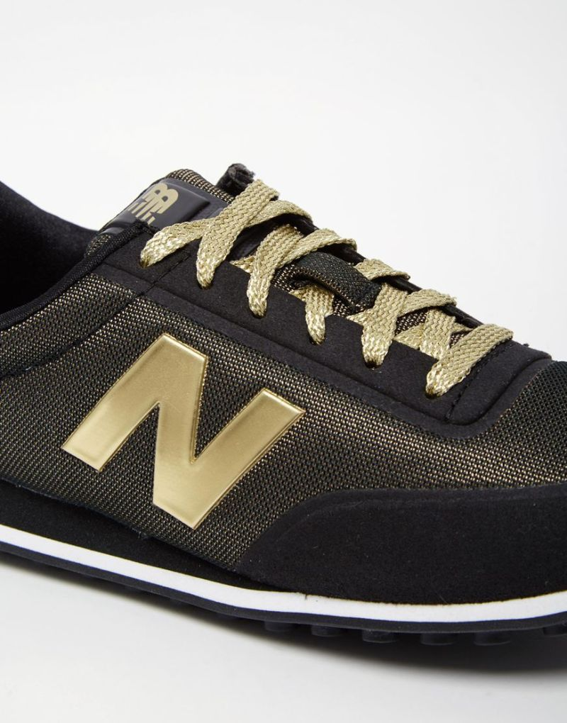 New balance black metallic gold trainers to my