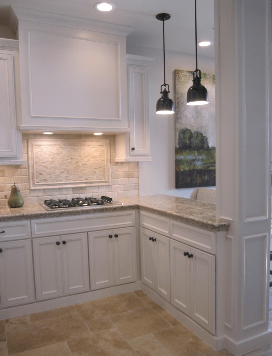 Kitchen with off white stone backsplash and