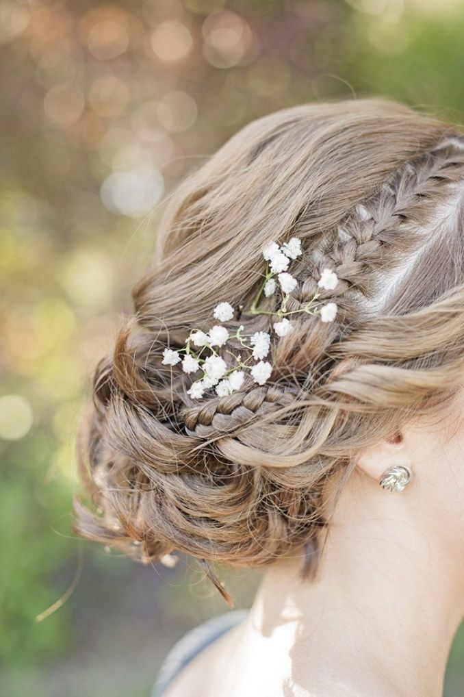 gorgeous braided updo and tug a sprig of baby's breath in hair