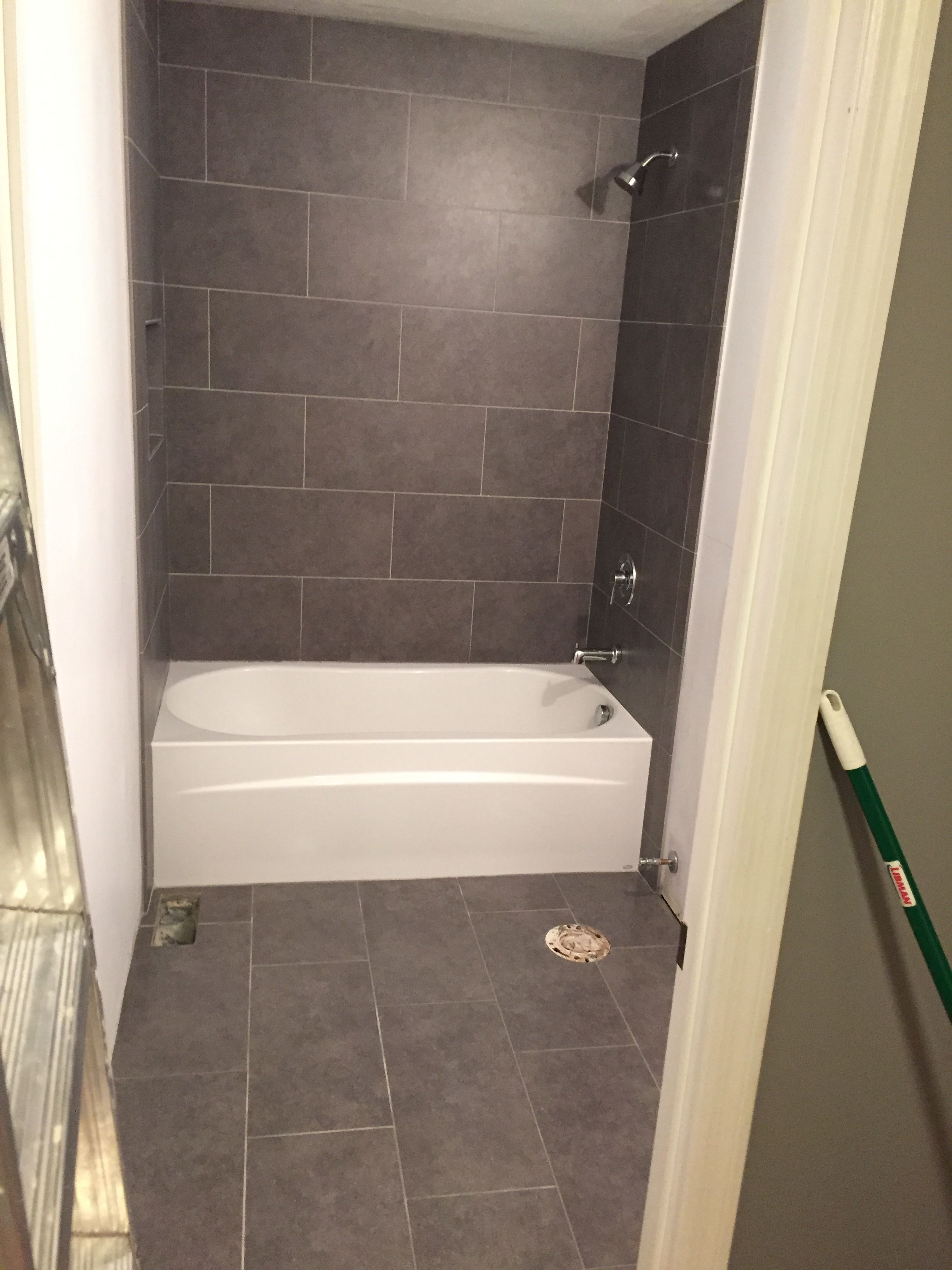 Lowe's mitte gray tile 12x24 bathroom tub surround and