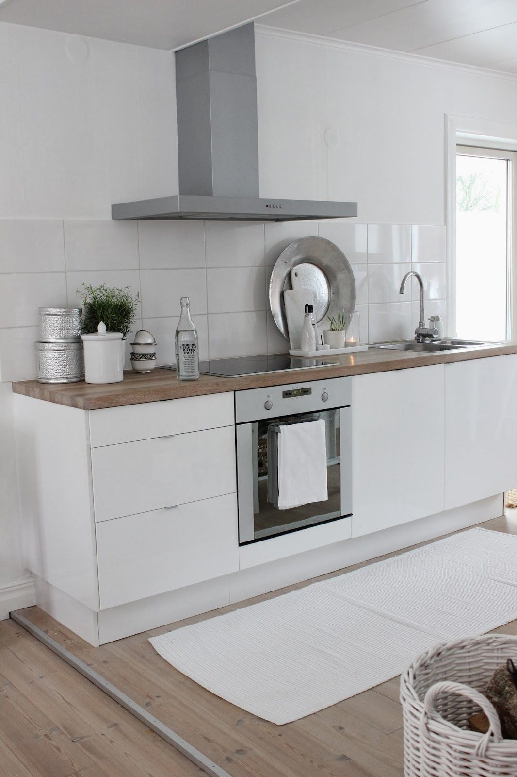 13. Tiny white contemporary kitchen with wooden