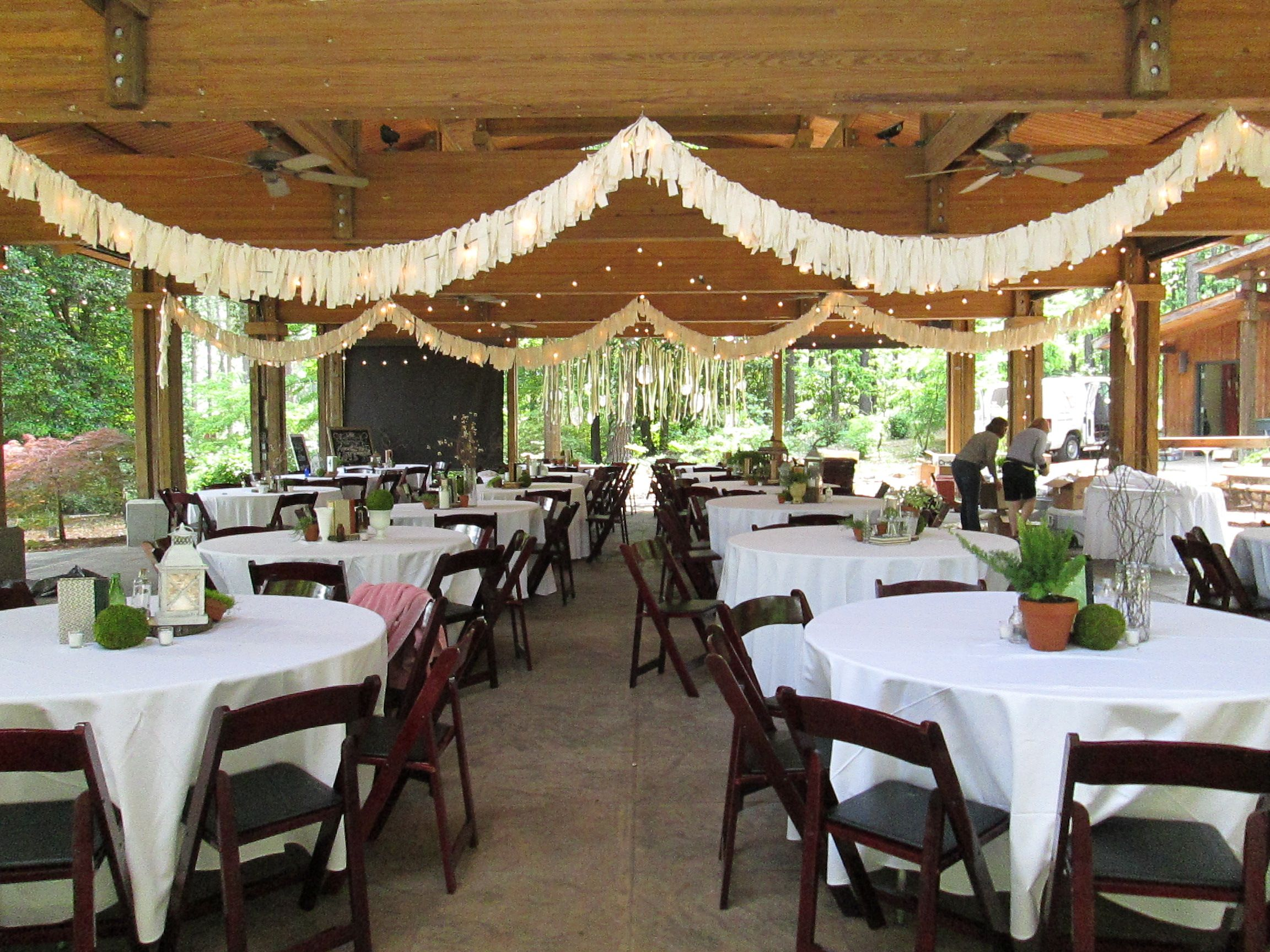 Stringing Lights And Banners Under The Pavilion #wedding
