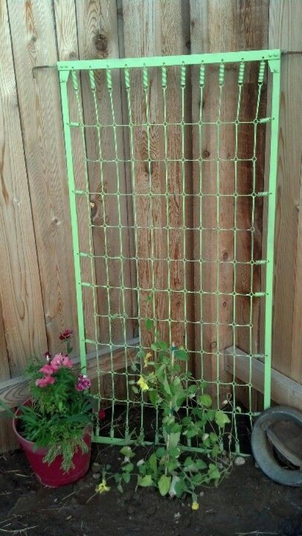 10 ways to repurpose a baby crib - mattress springs propped in the corner as a trellis.
