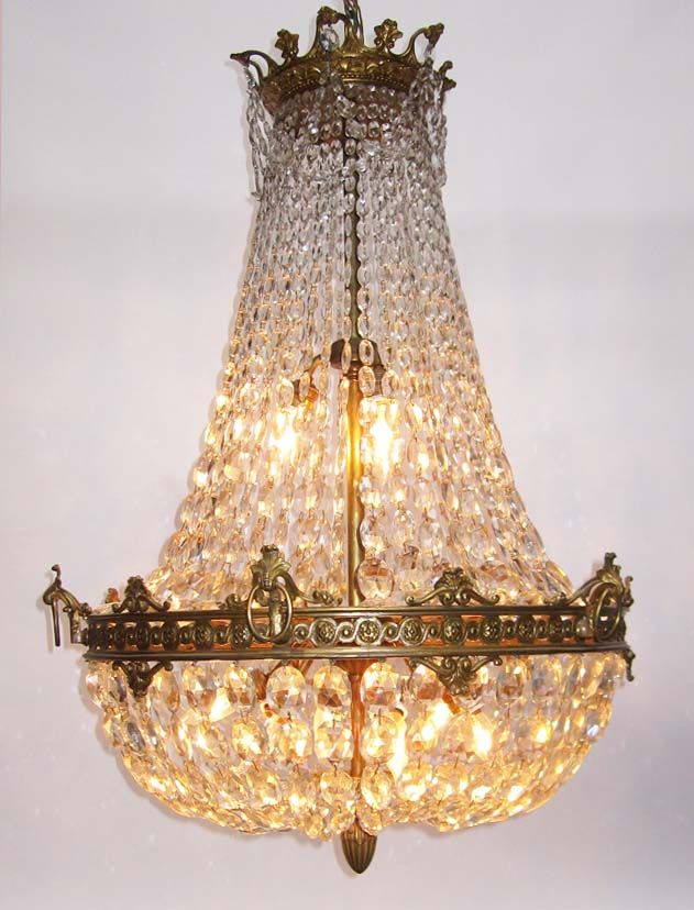 A Fine French Century Empire Style Gilt Bronze And Diamond Cut Crystal Basket Nine Light Chandelier With Fl Trim Acanthus Hooks Holding Rings