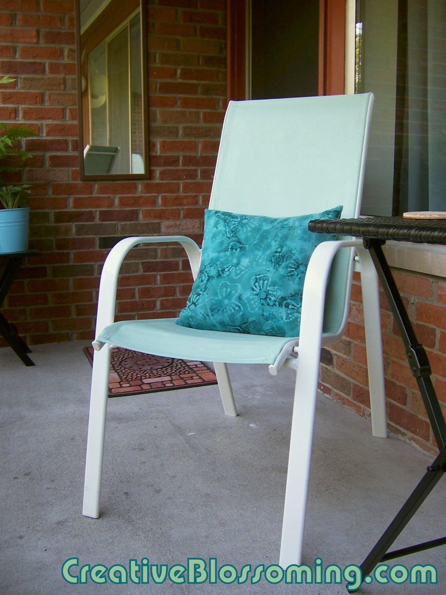 Painted patio chair. She used latex indoor paint on mesh