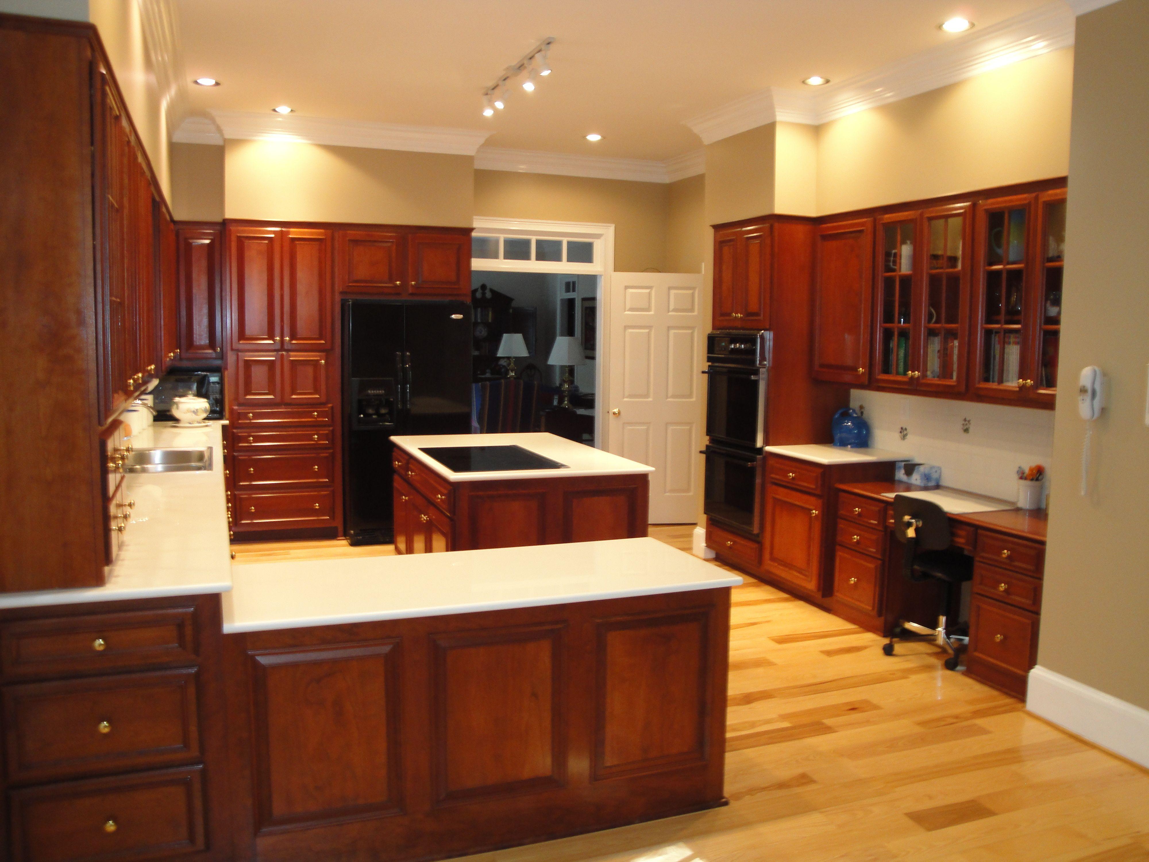 hickory floors, cherry Black appliances. Counter
