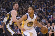 December 23, 2015; Oakland, CA, USA; Golden State Warriors guard Stephen Curry (30) dribbles the basketball against Utah Jazz forward Gordon Hayward (20, left) during the second quarter at Oracle Arena. Mandatory Credit: Kyle Terada-USA TODAY Sports