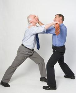 Two business men fighting, studio shot