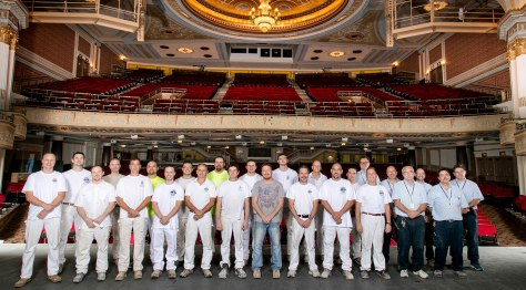 The State Theatre restoration was a collaborative effort of EverGreene Architectural Arts of New York and The Dependable Painting Company of Cleveland. Paint crews of the two firms pose on the stage with the Playhouse Square facilities staff