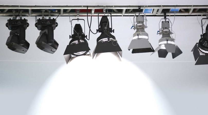 Stage lighting shining a spotlight downward