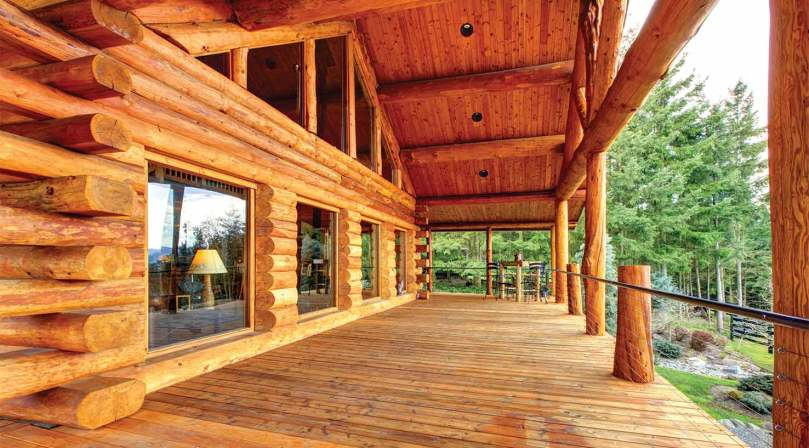 restained log home exterior