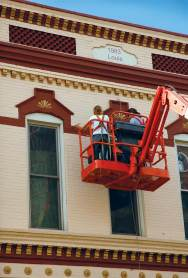 Larson Paint and Stain work from a lift to restore the exterior of the Frederick Rehfuss Building in La Crosse, Wis.