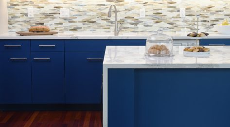 a kitchen remodel featuring bold blue painted cabinetry