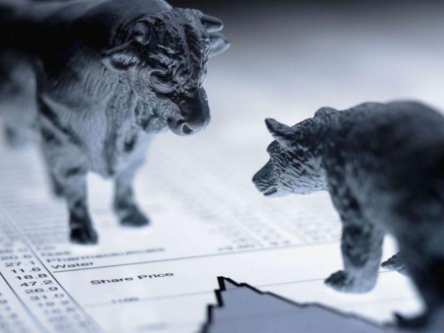 PHOTO: Bull and bear figurines on list of share prices