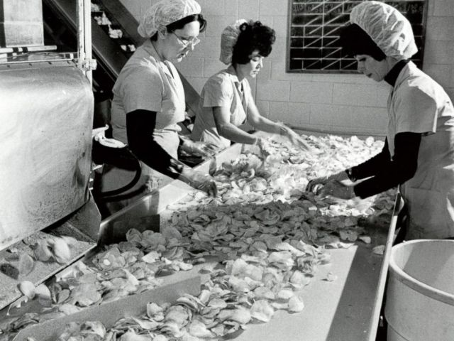 PHOTO: 1965 FIRST BBQ CHIP: Workers inspected the chips, which went for 10 cents a piece, before bagging them up.