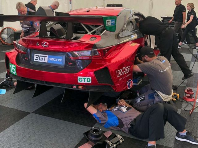 PHOTO: The crew preps one of the cars before a race at Lime Rock Park in Lakeville, Conn., July 21, 2018.