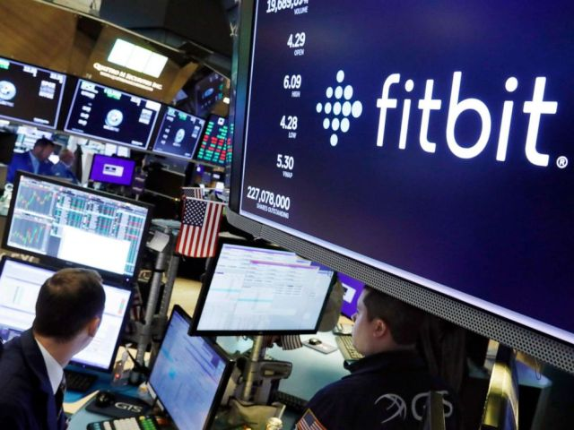 PHOTO: The logo for fItbit appears above a trading post on the floor of the New York Stock Exchange, Oct. 28, 2019.
