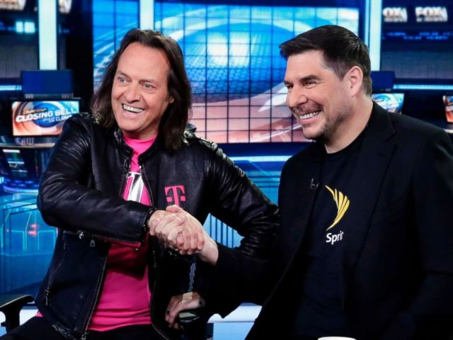 PHOTO: T-Mobile CEO John Legere and Sprint CEO Marcelo Claure shake hands as they are interviewed by Liz Claman during her Countdown to the Closing Bell program on the Fox Business Network, in New York, April 30, 2018.