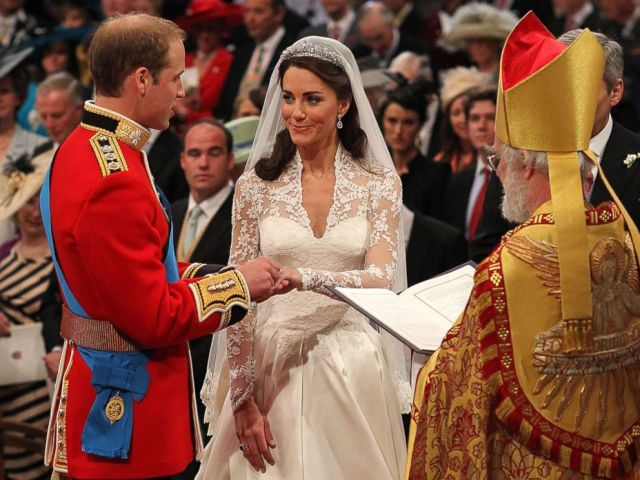 PHOTO: Britains Prince William and Kate Middleton exchange rings in front of the Archbishop of Canterbury at Westminster Abbey, London, April 29, 2011.