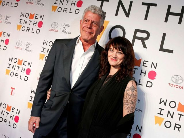 PHOTO: Anthony Bourdain poses with Italian actor and director Asia Argento for the Women In The World Summit in New York, April 12, 2018.
