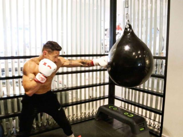 PHOTO: Noah Neiman demonstrates a boxing move at New York Citys Rumble Boxing Studio.