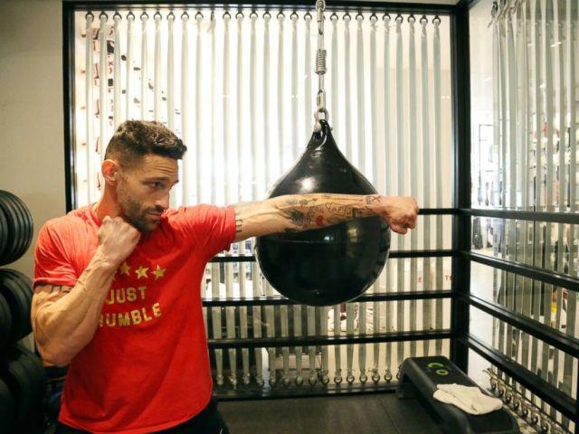 PHOTO: Noah Neiman demonstrates a move at New York Citys Rumble Boxing Studio.
