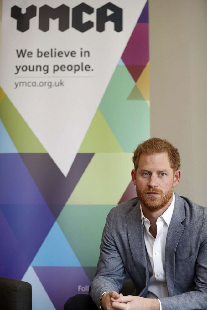 Britain's Prince Harry, Duke of Sussex listens to the Youth Ambassadors Mental Health Champions during a visit to YMCA South Ealing in west London on April 3, 2019.